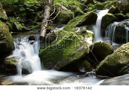 waterfall on mountains river by name Bila Opava at Mountains Jesenik at Czech republic at Europe