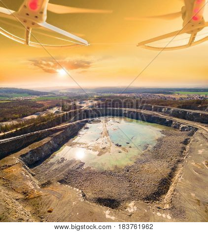 Aerial view to opencast mine. Use drones to inspect mining area. Modern technology theme.