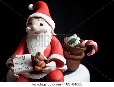Fondant Santa Claus doll cartoon toy,  black background