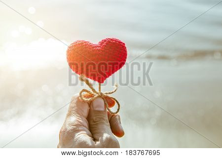 heart on the beach summer sea love sand for travel background.