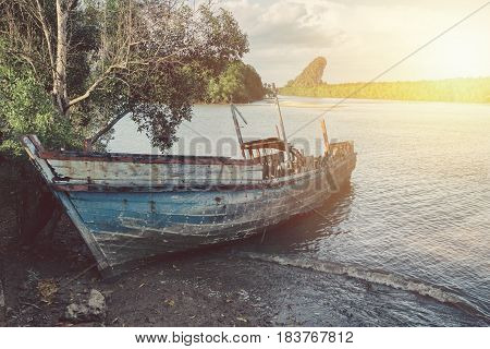 aged grunge shipwreck at the sea vintage retro old color tone