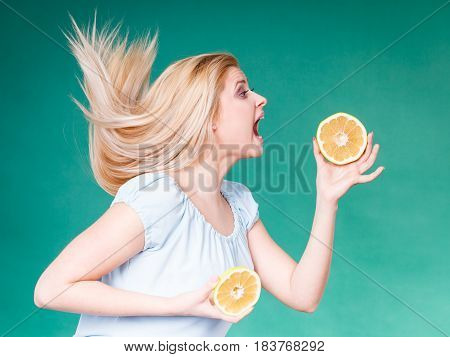 Woman With Open Mouth Holding Grapefruit