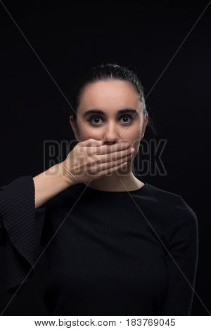 One Young Woman, Hand Covering Mouth