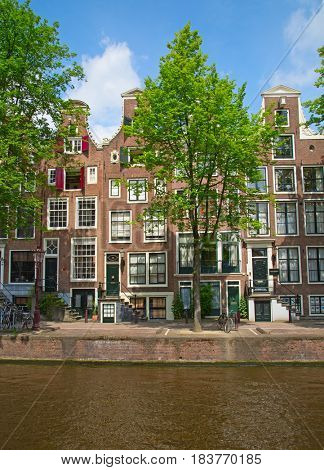 AMSTERDAM - JULY 10: Canals of the Amsterdam city on July 10, 2016 in Amsterdam, Netherlands. The historical canals and traditional dutch houses is one of the main attractions of Amsterdam.
