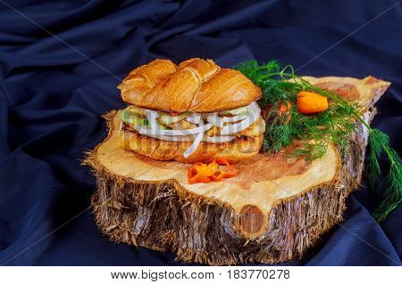 Chicken Sandwich With Onion Tomato Cucumber On A Wooden Stand