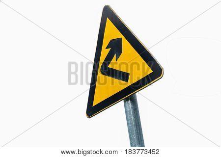 closeup of yellow arrow road signs .