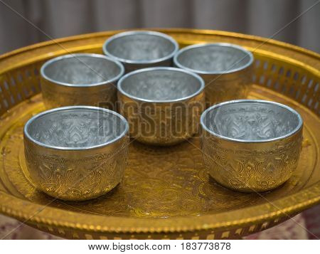 Silver Metal water dipper on tray with pedestal