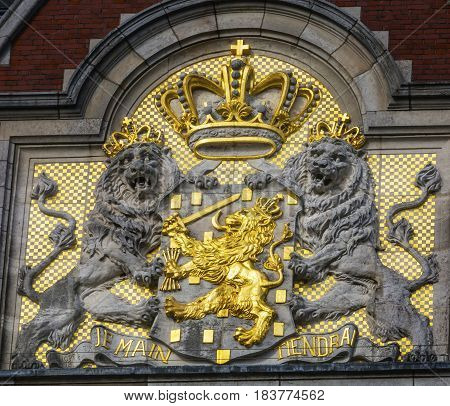 "Netherlands Coat of Arms Amsterdam Holland Netherlands. On Building Facing the Canal. Also symbol of Dutch Monarchy. Combines Lion of Dutch Republic with Nassau/Orange symbol. Je Maintiendrai ""I Will Maintain"" is the motto of the Dutch Royal Fam poster"