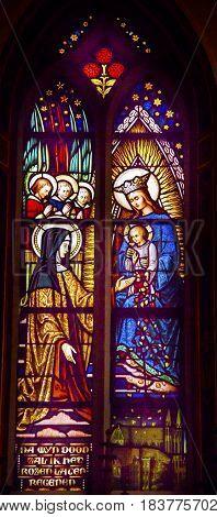 AMSTERDAM, NETHERLANDS - MARCH 30, 2017 Quenn Mary Baby Jesus Nun Stained Glass Window De Krijtberg Church Amsterdam Holland Netherlands.