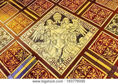 AMSTERDAM, NETHERLANDS - MARCH 30, 2017 Papal Keys Angels Tile Floor De Krijtberg Church Amsterdam Holland Netherlands. De Krijtberg may be the most beautiful church in Amsterdam.