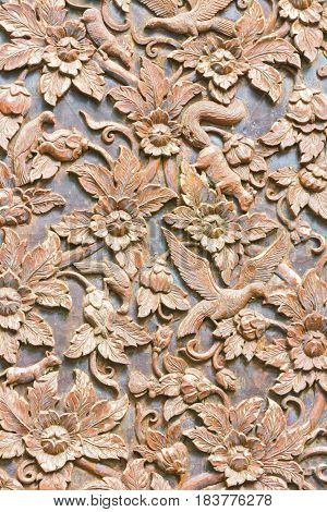 wooden carved bird and flowers used for background vertical background