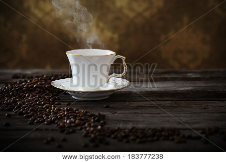 the cup of coffee on wooden table