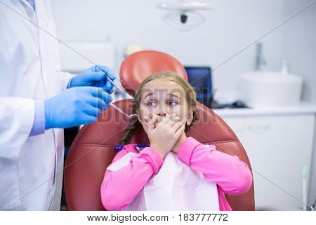 Young patient scared during a dental check-up at clinic