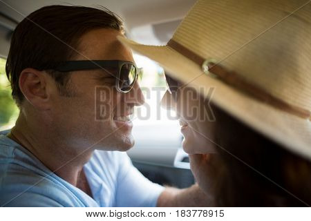 Close-up of romantic couple traveling in car