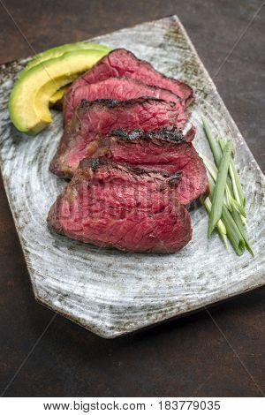 Japanese Kobe Steak Fillet with Avocado as close-up on a plate
