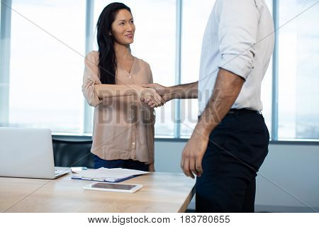 Business people shaking hands during meeting at office conference room