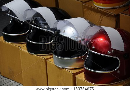 KUALA LUMPUR, MALAYSIA -FEBRUARY 25, 2017: Motorcycle helmets in various color with retro design. This design was popular during 50's and 60's.