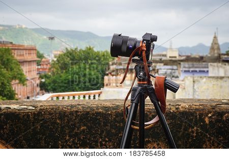 Digital Camera With Tripod On The Old Building