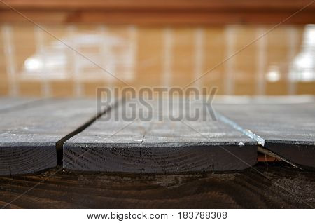 Wooden background. Dark wood boards in perspective closeup. Selective focus. For presentation of objects.