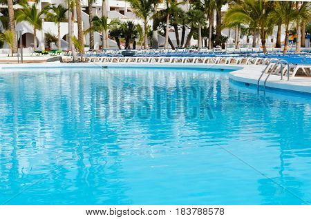 Beautiful swimming pool in tropical resort hotel Vacation time holyday background.