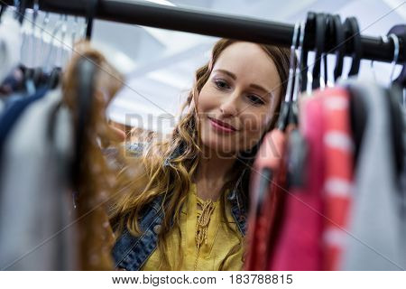 Beautiful woman doing shopping at clothes store