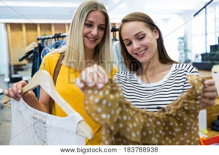 Beautiful women doing shopping at clothes store