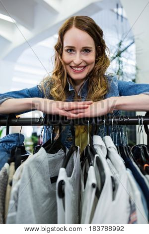 Portrait of woman doing shopping at clothes store