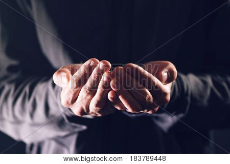 Cupped hands asking for money poor male beggar needs charity and help