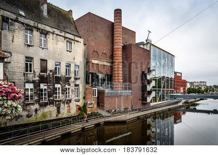 Mechelen Belgium - July 30 2016: Lamot conference centre situated at the waterside in the historic centre of Mechelen. The former brewery is one of the most daring feats of contemporary architecture.