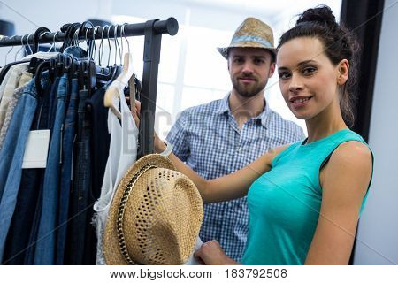 Portrait of couple doing shopping at clothes store
