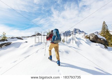Man with hiking equipment walking in Sierra Nevada mountains, California, USA