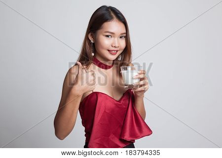 Healthy Asian Woman Drinking A Glass Of Milk Thumbs Up.