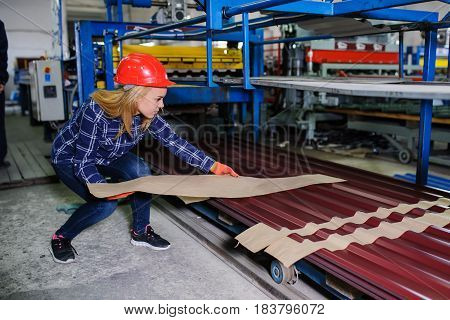 Woman In Red Safety Helmet Work As Industrial Worker