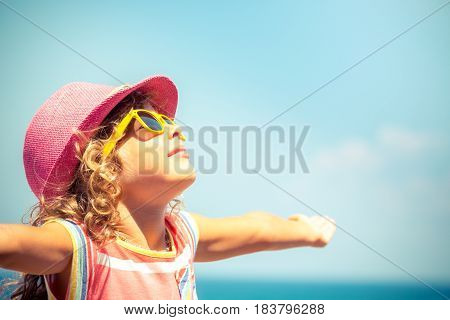Child Against Blue Sky Background