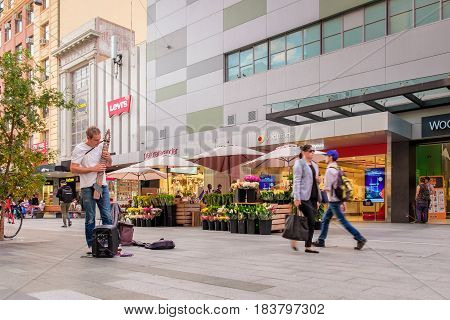 Adelaide Australia - April 05 2017: Musician plays his guitar at Rundle Mall in Adelaide CBD near the flower shop. Rundle Mall is the busiest place in Adelaide