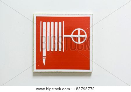 Fire hose symbol in red and white squares