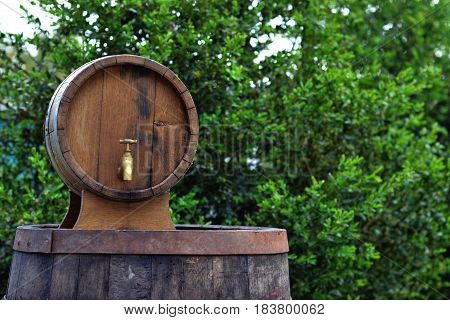 Beautiful background of old barrels in nature