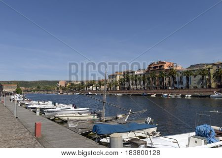 View of the Temo River crossing the village of Bosa. Fishermen's boats.