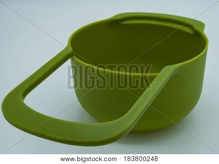 Colorful plastic measuring cups set and measuring cups different sizes on white background.