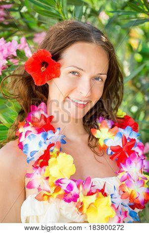 Woman In Hawaiian Flowers Garland