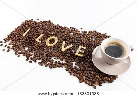Cup Of Coffee And Coffee Beans With Cookies In Shape Of Love Word Isolated On White