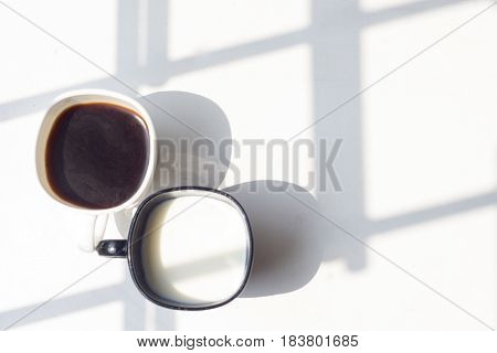 Black And White Cup Of Milk, Coffee On Natural Background, Top View