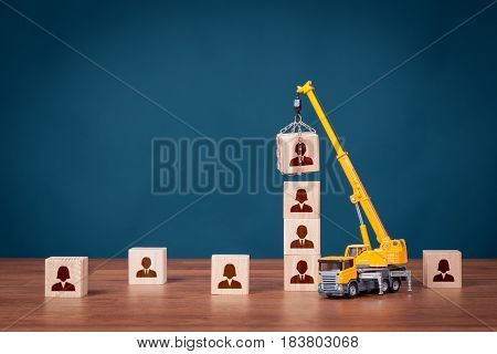 Build team, hire and recruitment concepts. Recruiter represented by crane complete team by leader (CEO).