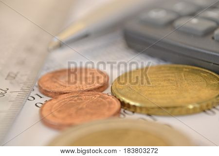 Financial background with money calculator ruler digits and pen.