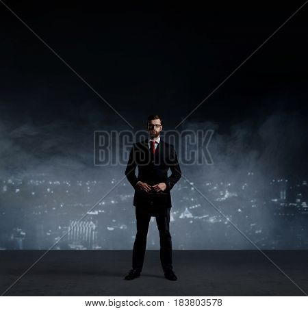 Businessman with briefcase standing over night city background.  Job, business, career, concept.