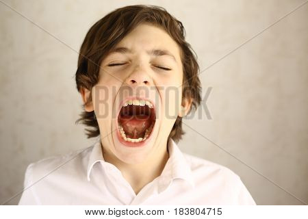 Teenager Boy Yawning Open Mouth