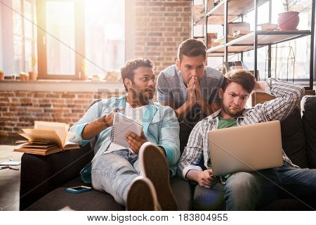 Young Professionals Working On New Business Project With Laptop In Small Business Office