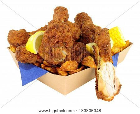 Southern fried chicken portions in a cardboard take away tray isolated on a white background