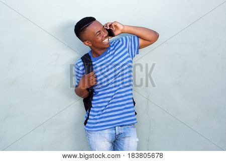 Happy Young African American Male Student Talking On Mobile Phone
