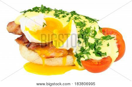 Eggs Benedict with a fresh poached egg and hollandaise sauce on an English Muffin isolated on a white background
